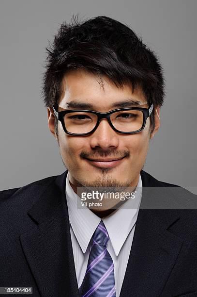 expression de visage Homme d'affaires asiatique
