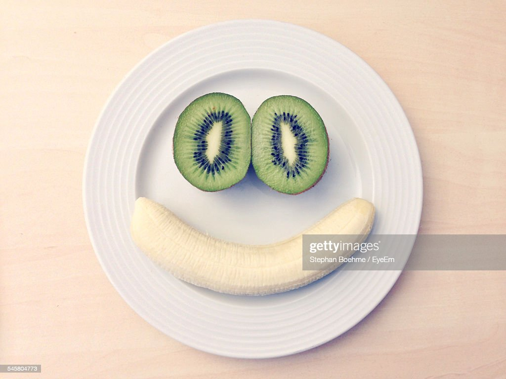Face Made From Banana And Kiwi On Plate : Stock Photo
