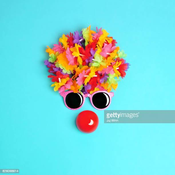 face made from flowers and sunglasses with red clown nose - clown's nose stock photos and pictures
