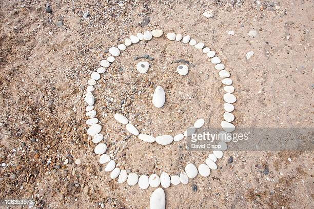 A face made of pebbles on the beach in Bridlington in East Yorkshire, England, UK