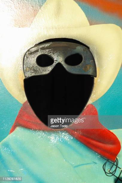 face mask cut out with blank face and cowboy hat with red scarf