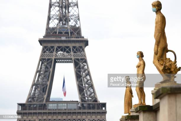 A face mask is seen on a golden statue at Trocadero square as the lockdown continues due to the epidemic of coronavirus on May 10 2020 in Paris...