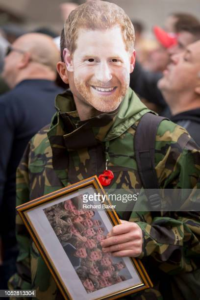 A face mask of army veteran Prince Harry is worn by a rightwing supporter of the antiIslam activist Tommy Robinson outside the Central Criminal Court...