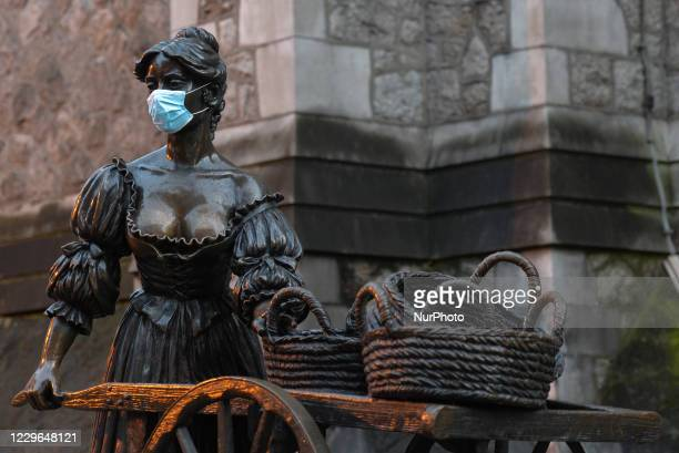 Face mask seen on a statue of Molly Malone at the current location on Suffolk Street, Dublin On Monday, November 16 in Dublin, Ireland.