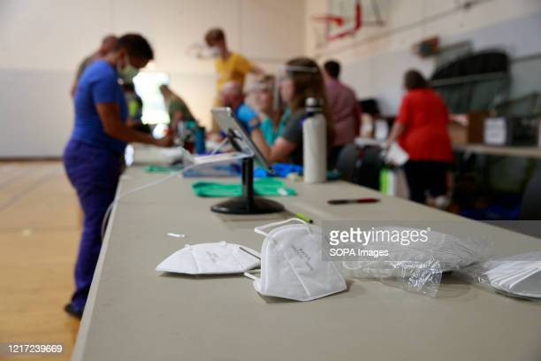 Face masks are made available to voters as a precaution against the spread of COVID-19 at Edgewood High School during Indiana Primary Election Day....