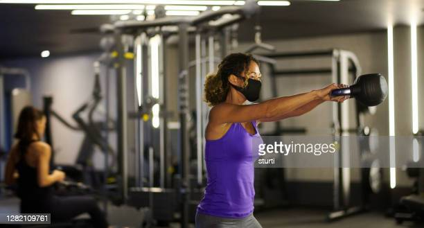 face masks at the gym - protective face mask stock pictures, royalty-free photos & images