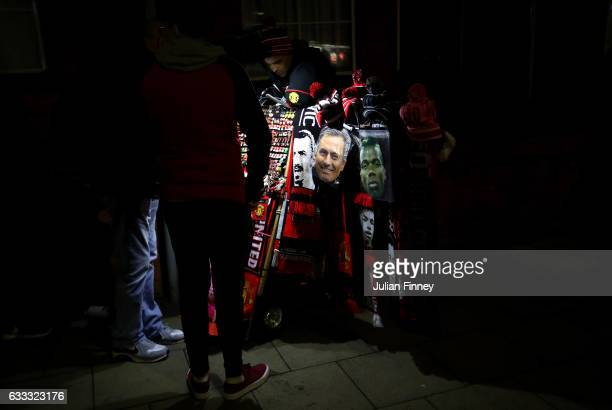 Face masks of Jose Mourinho Manager of Manchester United and Paul Pogba are sold on a merchandise stall prior to the Premier League match between...