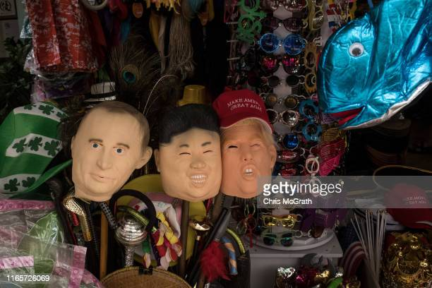 Face masks of Russian President Vladimir Putin, Supreme leader of North Korea, Kim Jong-Un and U.S. President Donald Trump are seen for sale at a...