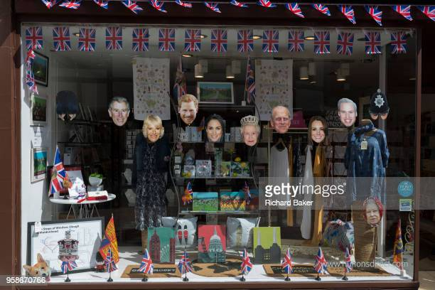 Face masks of the royal family in a shop window as the royal town of Windsor gets ready for the royal wedding between Prince Harry and his American...