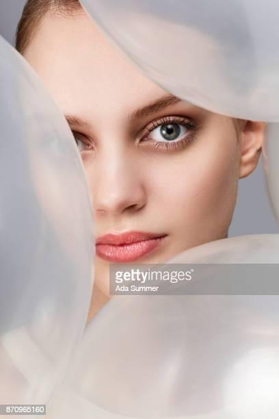 face of a beautiful woman between ballons