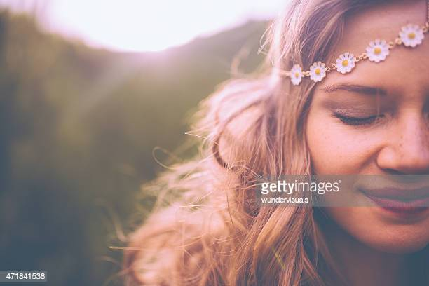 Face of a boho girl with a vintage flowered headband