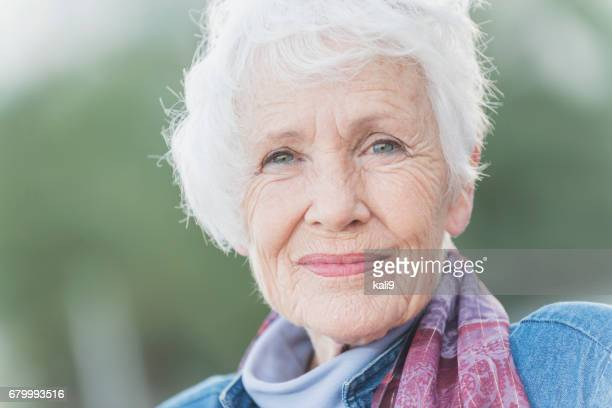 Face of a happy senior woman in her 70s