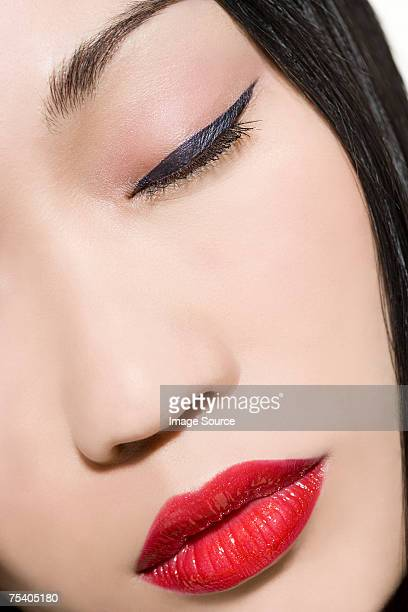 face of a woman with eyeliner and lipstick - eye liner stock pictures, royalty-free photos & images