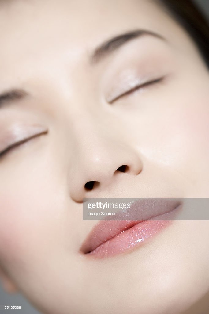 Face of a young woman : Stock Photo