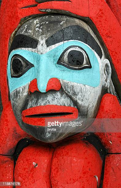 face of an alaskan totem pole. - totem pole stock pictures, royalty-free photos & images