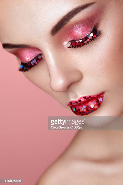 Face Of Beautiful Woman With Holiday Makeup Heart