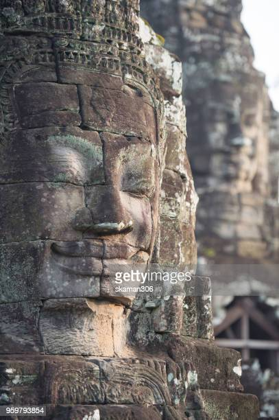 face  of bhudha at bayon temple - khmer art stock photos and pictures