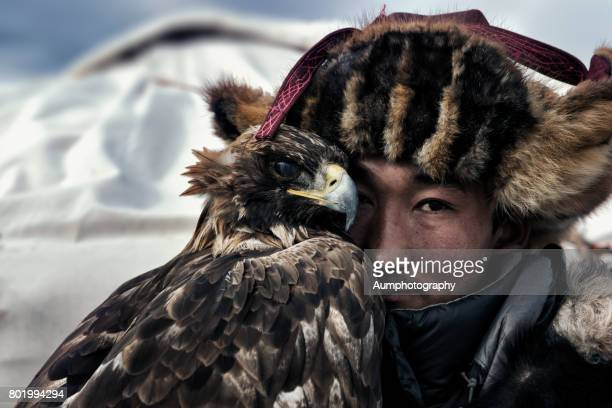 face of eagle hunter, mongolia. - independent mongolia stock pictures, royalty-free photos & images