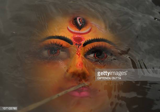 A face of Hindu goddess Durga floats after the immersion of idols in the river Mahananda during the Dusshera or Vijaya Dashami Festival the final day...