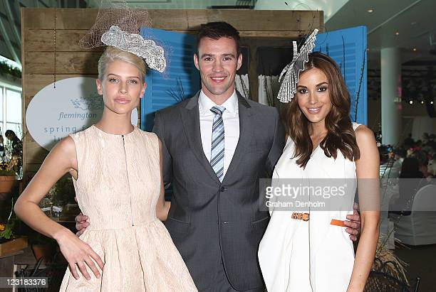 Face of Melbourne Spring Fashion Week Sophie Van Den Akker poses with Myer Racing Ambassadors Kris Smith and Rebecca Judd at the Flemington Spring...
