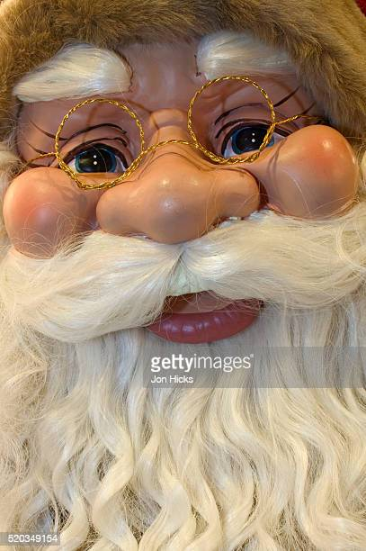 face of santa claus doll at nuremberg christmas market - santa face stock pictures, royalty-free photos & images