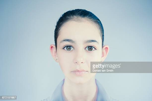 Face of wide-eyed Mixed Race girl