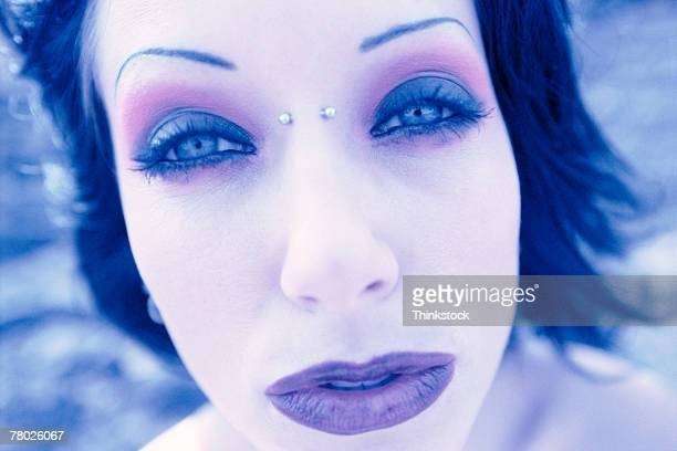 Face of woman posing outdoors