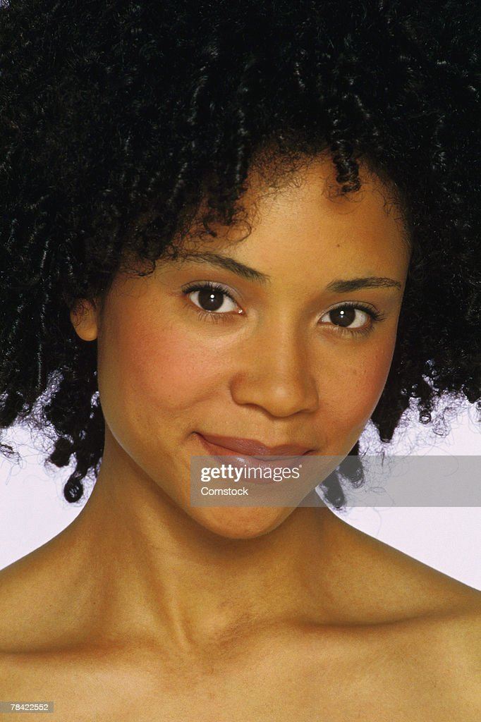Face of woman with afro hairstyle : Stock Photo