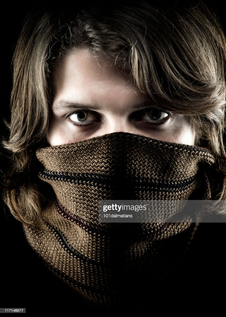 Face of young man wrapped scarf : Stock Photo