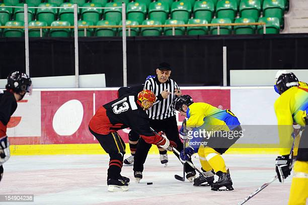 face off during ice hockey game - ice hockey stick stock pictures, royalty-free photos & images