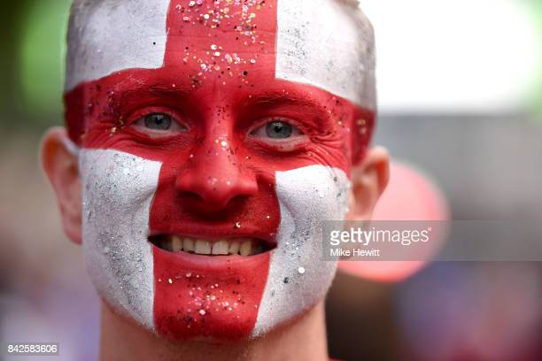A face painted England fan enjoys the atmosphere prior to the FIFA 2018 World Cup Qualifier between England and Slovakia at Wembley Stadium on...