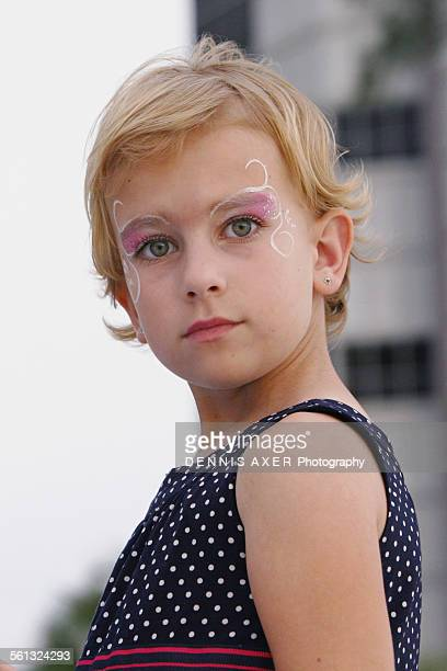 face painted young girl looking - n n girl model stock photos and pictures