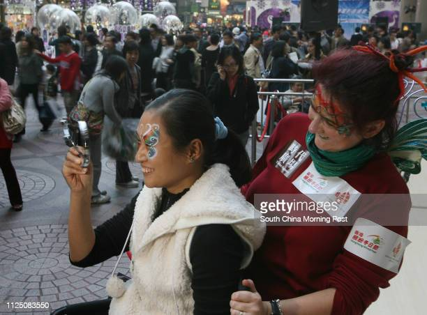 Face painter Catriona Finlayson with her doing face painting for audiences during Tourism Board's WinterFest promoting function at the Time Square...