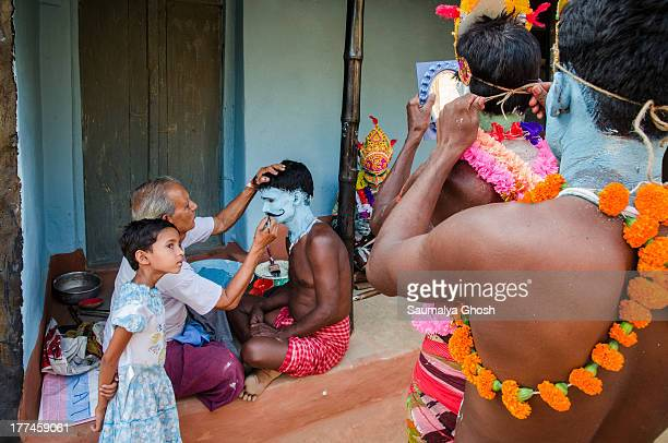 CONTENT] Face painting at Gajan festival Gajan is a Hindu festival celebrated mostly in the Indian state of West Bengal