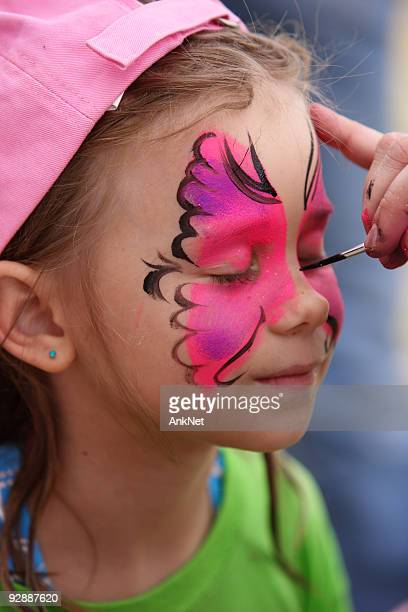 Face painting at the party.