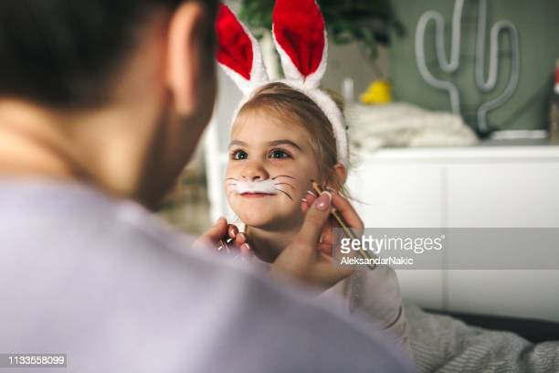 face painting for little easter bunny - happy easter mom stock pictures, royalty-free photos & images