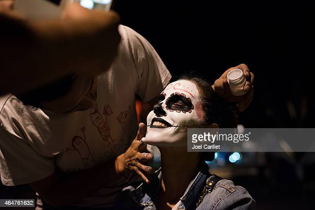 face painting in oaxaca during dia de los muertos - day of the dead stock photos and pictures