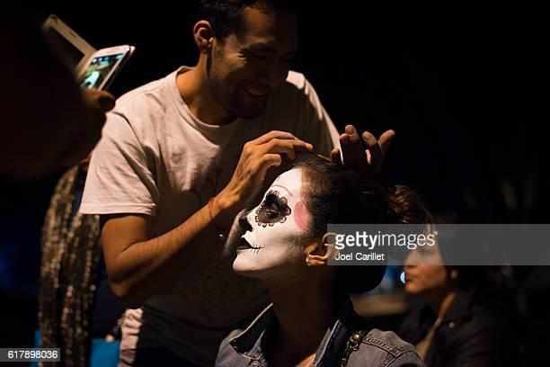 Face painting in Oaxaca during Dia de los Muertos