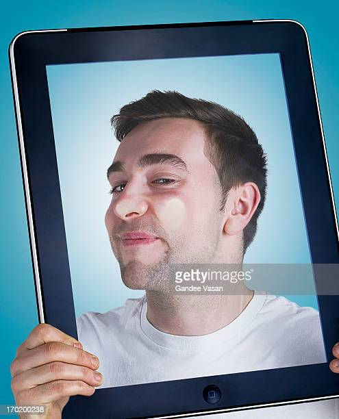 face pressing against tablet computer - gandee stock pictures, royalty-free photos & images