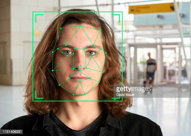 face recognition markings on the face of a long-haired young man. - facial recognition technology stock pictures, royalty-free photos & images