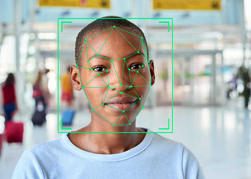 Face recognition markings on the face of a short-haired young woman. - gettyimageskorea