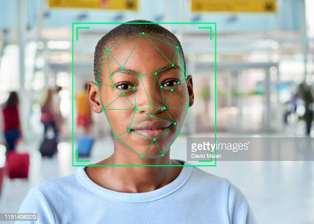 face recognition markings on the face of a short-haired young woman. - facial recognition technology stock pictures, royalty-free photos & images