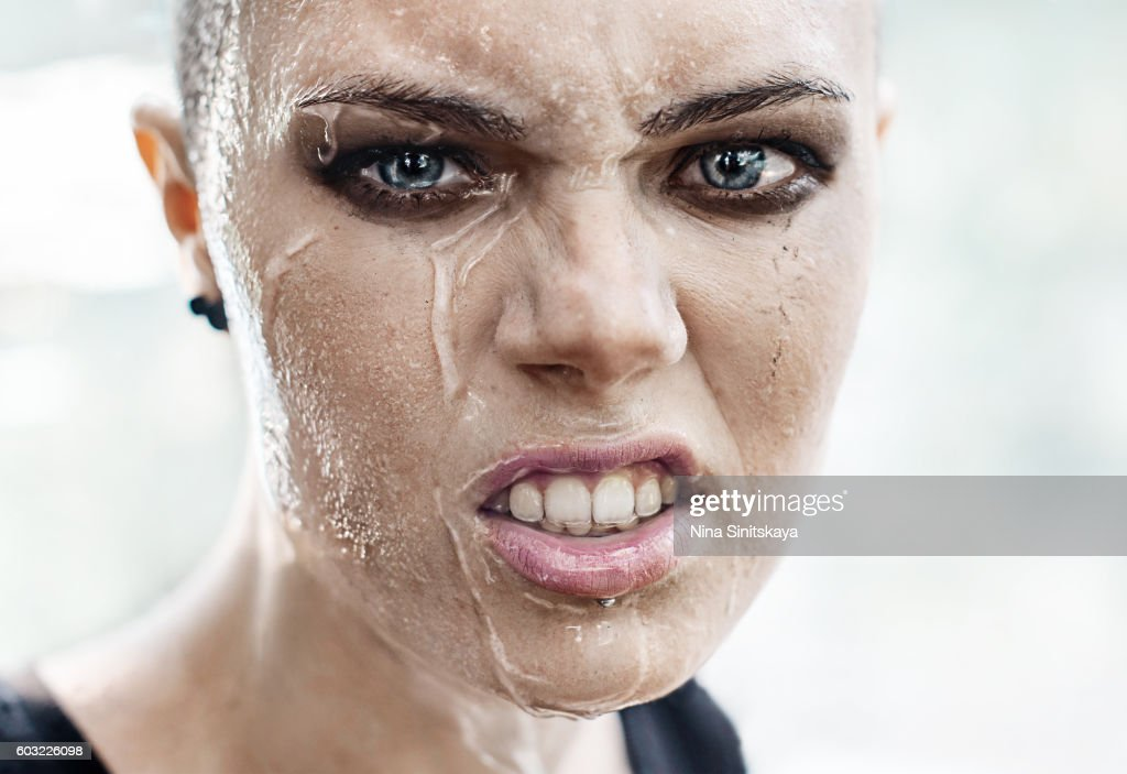 face shot of angry woman crying under the rain stock photo getty