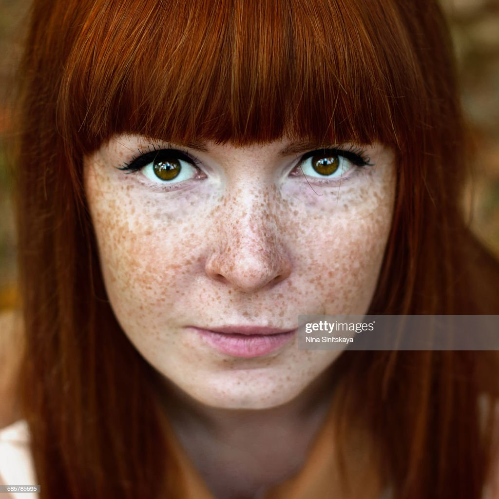 Face shot of beautiful red woman with freckles : Stock Photo