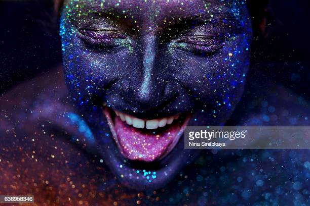 Face shot of Girl in glitter laughing