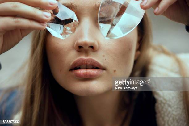 face shot of woman covering eyes with glass crystals - crystal stock pictures, royalty-free photos & images