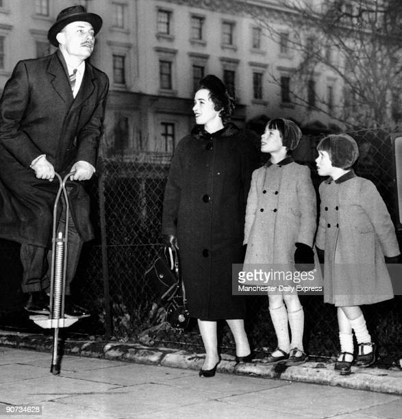 'Face tense knees braced Homburg firmly set up and down he goes in Belgravia the envy of every child in sight Mr Enoch Powell 49yearold Minister of...