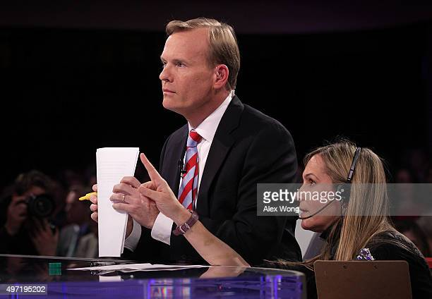 Face the Nation anchor John Dickerson listens to a crewmember prior to a presidential debate sponsored by CBS at Drake University on November 14 2015...