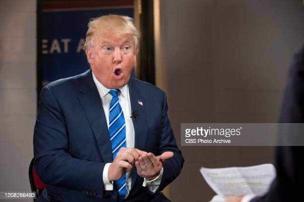 """Face the Nation"""" anchor John Dickerson talks with GOP Presidential candidate Donald Trump in Raleigh-Durham, NC, December 4, 2015."""