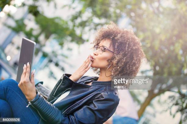 face time with the loved one - long distance relationship stock pictures, royalty-free photos & images